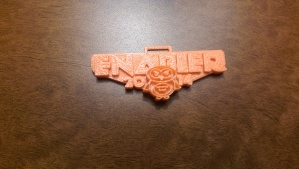 Snazzy 3D printed Enabler badge.